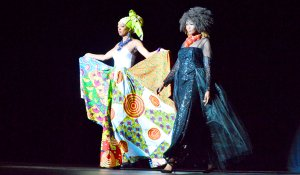 A duo of models in contrasting fabric shades and adornments stepped onstage, emphasizing the potential of fashion to fuse cultures and concepts during the Dallas International Fashion Show inside the Music Hall at Fair Park, Sept. 4.