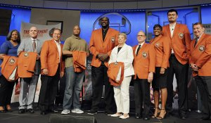 The 2016 class of inductees into the Basketball Hall of Fame, from the left: Ann Beaty, accepting on behalf of her late husband Zelmo Beaty; Ron Garretson, accepting on behalf of his father the late Darell Garretson, Tom Izzo; Maurice Banks, accepting on behalf of his late grandfather John McLendon; Shaquille O'Neal; Nancy Boxill, accepting on behalf of her late grandfather Cumberland Posey; Jerry Reinsdorf; Sheryl Swoopes and Yao Ming, pose with past inductee Jerry Colangelo for a group photo at the end of a news conference at the Naismith Memorial Basketball Hall of Fame, Sept. 8, in Springfield, Massachusetts.
