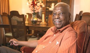 Nathaniel Bradford, posing at his home in Austin, was one of the first Black undergraduates at the University of Texas. He enrolled 60 years ago. Bradford will be honored at the university with a series of activities.