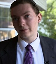 """Sitting in his parent's living room in suburban New York, Youtube food reviewer """"ReportOFTheWeek"""" skeptically eyes his newest subject: Burger King's Cheetos Chicken Fries."""