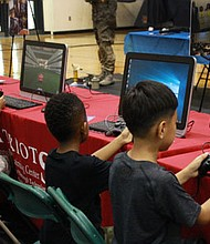 Attendees try out the flight simulator