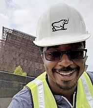 Travis McPhail, software engineer at Google, stands in front of the National Museum of African American History and Culture.