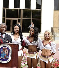 Prince George's County Executive Rushern L. Baker III speaks during a Washington Redskins rally outside the administration building in Upper Marlboro on Sept. 7. (Mike Yourishin/Office of the County Executive)