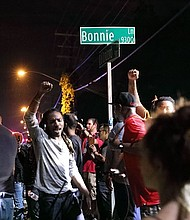 For a second night, protests over a deadly officer-involved shooting in Charlotte, North Carolina, turned violent, with police firing tear gas and demonstrators throwing objects and trying to damage vehicles.