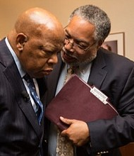 Rep. John Lewis (left), seen here with Lonnie Bunch, director of the Smithsonian National Museum of African American History and Culture, was a driving force behind the new museum. (Courtesy photo)