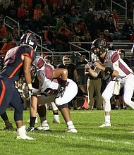 Plainfield North quarterback Brady Miller awaits the shotgun snap in the Tigers' 12-0 loss against Oswego on Sept. 16.