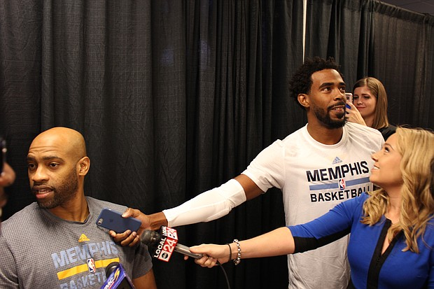 Mike Conley clowns with teammate Vince Carter and other media during Grizzlies Media Day at FedExForum on Monday, September 26.