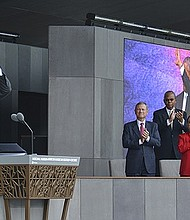 President Barack Obama waves to the crowd during the grand opening ceremony for the National Museum of African American History and Culture on the National Mall in Washington, D.C.