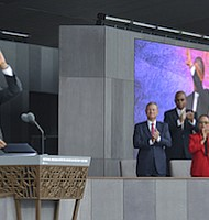President Obama waves to the crowd during the grand opening ceremony for the National Museum of African American History and Culture on the National Mall in Washington, D.C. on Sept. 24. (Freddie Allen/AMG/NNPA)