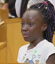 Zianna Oliphant climbed up a step ladder to stand at the podium before a tense Charlotte City Council meeting and amade a tearful plea saying black parents are getting killed.