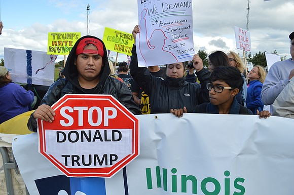 Residents came out to protest Donald Trump's fundraising luncheon at the Bolingbrook Golf Club on Wednesday.