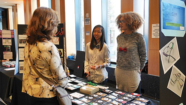 High school students in BUILD Boston's entrepreneurship program work on selling their bowtie creations. The youth marketplace in the Bolling Building was part of a HUBWeek event on Sept. 26.