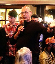 Busboys and Poets restaurant owner Andy Shallal hosts a presidential debate watch party and panel discussion at the restaurant's northwest D.C. location on Monday, Sept. 26.