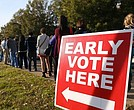 People line up for early voting outside the Pulaski County Regional Building on Nov. 3, 2014, in Little Rock, Ark.