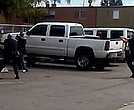 Police in El Cajon, Calif., provided this image, which they say is a still from a bystander's cellphone video of the shooting of an unarmed black man on Tuesday. Police say the man was pointing an object — which was not a weapon — at an officer. El Cajon Police Department