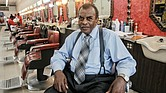 Franklin Harvey Sr., 83, reflects at Harvey's Progressive Barber Shop, home of the Afro Master comb, at 22 E. Broad St. The shop is the last of two he owned and operated in Downtown for more than 40 years.