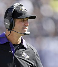 John Harbaugh looks on from the sidelines as the Baltimore Ravens faced the Oakland Raiders last season.
