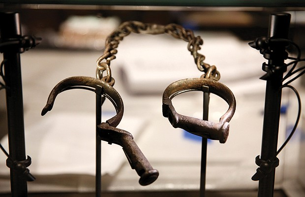 """Slave shackles on display in the """"Slavery and Freedom"""" exhibition of the National Museum of African American History and Culture."""