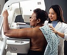 Woman receiving mammogram.