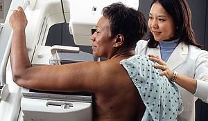 Woman receiving mammogram.