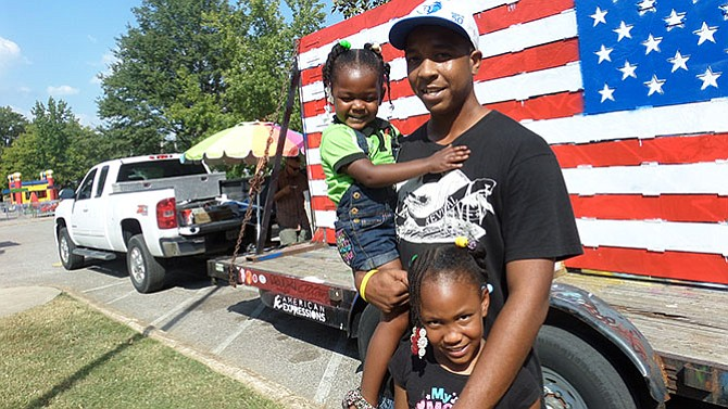 Jamie King brought his two daughters, Samayaa (l) and Aniyah Smith (r) to the event so they could have fun.