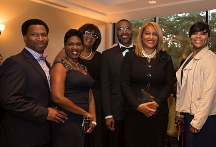 The Perfecting Church -- Michael and Tammi Dixon, Regina Egerton, Pastor Kevin C. and Angela Brown, and LeToyja and Brian Averhart with Elleanor Jean Hendley of Teenshop, Inc.