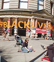 Portland City Hall is draped in protest banners as activists from Black Lives Matter, Don't Shoot PDX and other civil rights groups oppose a new collective bargaining agreement with the union that represents members of the Portland Police Bureau.