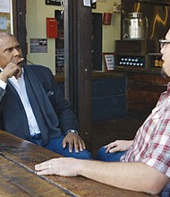 Tavis Smiley with small business owner Sal Bednarzin in his PBS special, 'Getting Ahead,' a one hour documentary on the impact of the rising minimum wage, airing Friday, Oct. 7 at 9 p.m. on PBS.