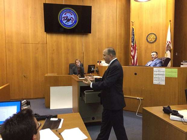 Photo:  Will County Assistant State's Attorney Chris Koch demonstrates some of the new features of the county's new e-courtroom. (photo by Brock A. Stein)