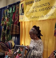 Vendor Janine Bell of the Elegba Folklore Society in Richmond, Virginia, attends the annual meeting and conference of the Association for the Study of African American Life and History in Richmond.