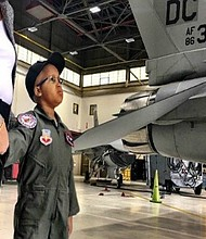 A Virginia boy put his cancer battle on hold to be a pilot -- just for a day -- at Joint Base Andrews in Maryland. Eight-year-old Kwami Penty of Falls Church, Virginia, has a rare malignant brain tumor, but on Thursday he took a break from chemotherapy for what would end up being a very special experience. **Embargo: Phoenix**