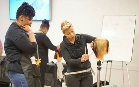 "Evalyn ""Evie"" Johnson has traveled the world to share the hair care techniques she's honed over 20 years as a ..."