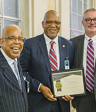 Rev. Dr. LeRoy Haynes Jr. (from left) of the Albina Ministerial Alliance and a long time leader for the group's Coalition for Justice and Police Reform, joins Portland Police Bureau Captain Kevin Modica and U.S. Attorney for Oregon Billy J. Williams at a national conference on community policing at the Justice Department in Washington, D.C.