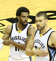 The Grizzlies' Mike Conley Jr.  (left),  who celebrated his birthday on Tuesday, confers with center Marc Gasol. (Photo: Warren Roseborough)