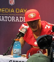 San Francisco 49ers quarterback Colin Kaepernick talks with reporters during Super Bowl Media Day on January 29, 2013 in New Orleans, Louisiana. The 49ers face the Baltimore Ravens for the NFL championship on Sunday, February 3, 2013.