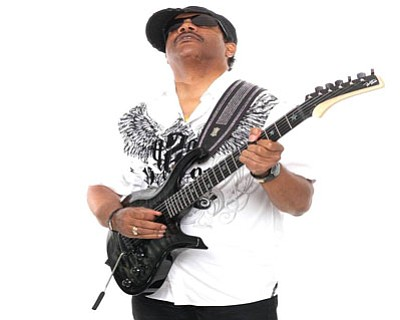 Being born in the Philippines and raised in the Bahamas and the United States makes jazz guitarist Vernon Neilly a ...