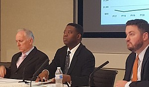 Metro Chief Financial Officer Dennis Anosike (center) briefs the agency's finance committee on Oct. 13 about its $275 million budget shortfall.