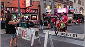 One tourist snaps a photo for another family visiting Beale Street for the first time. But the question of who will manage Tennessee's top tourism attraction remains undecided. (Photo: Lee Eric Smith)