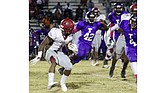 East running back Tim Taylor, who is committed to the University of Memphis, shows his quick-stop ability against Trezevant defenders.