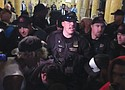 Police officers push activists out of Portland City Hall in a violent confrontation captured in a public Youtube video from Oregonlive.com.  The protesters were upset about a closed-door City Council session in which a new police union contract was ratified, a labor agreement that the racial justice activists say let police off the hook over demands for more accountability.