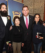 Mayor Martin Walsh and BPD Commissioner William Evans present the family of Officer Jose Maceira, who was killed in the line of duty in 1974, with a Boston Police Medal of Honor and an American flag. His name was also placed on the Boston Police Department's fallen officers wall at Boston Police Headquarters.