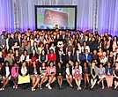 Disney Dreamers join (behind Mickey Mouse L-R) Mikki Taylor, editor-at-large for Essence Magazine, Michelle Ebanks, president of Essence Communications, Inc., radio and TV personality Steve Harvey, Tracey D. Powell, executive champion of Disney Dreamers Academy, and Mickey Mouse on March 6, 2016 to celebrate the commencement of the ninth Disney Dreamers Academy with Steve Harvey and Essence Magazine at Walt Disney World Resort in Lake Buena Vista, Fla. The annual event is a career-inspiration program for distinguished high school students from across the U.S.