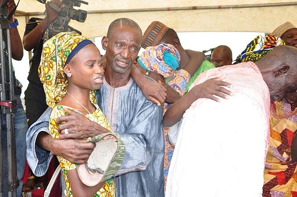 In a sight that could make a witness choke up with tears, a roomful of rescued Nigerian schoolgirls from Chibok ...
