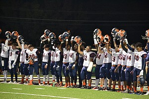 Romeoville Spartans lining up for the National Anthem before the team's Oct. 14 game at Plainfield Central in which it won 52-14.