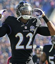 Baltimore Ravens cornerback Jimmy Smith pumps up the crowd at M&T Bank Stadium before a play during the 2015 NFL season.