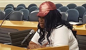 Chauniece Jones of Largo testifies at an Oct. 20 public hearing on Metro's proposal to permanently cut back late-night train service.