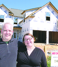 """Aaron Joy and Mary McDonald, who are engaged to be married this year, visited their """"dream house"""" under construction in Hancock Heights Phase II in Decatur."""