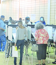 Early voters cast ballots on Oct. 19 at the polling place at the Gallery at South DeKalb in Decatur. In the first three days of early voting in the Nov. 8 elections, 25,725 DeKalb voters cast ballots.