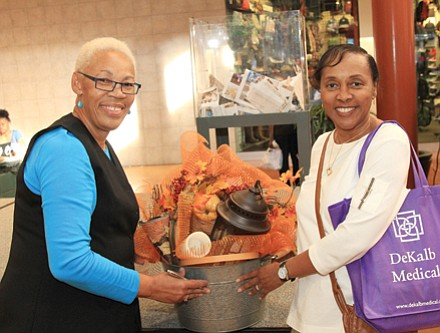 Grand prize winners included Pat Tucker (with CrossRoadsNews Publisher and Editor Jennifer Parker).