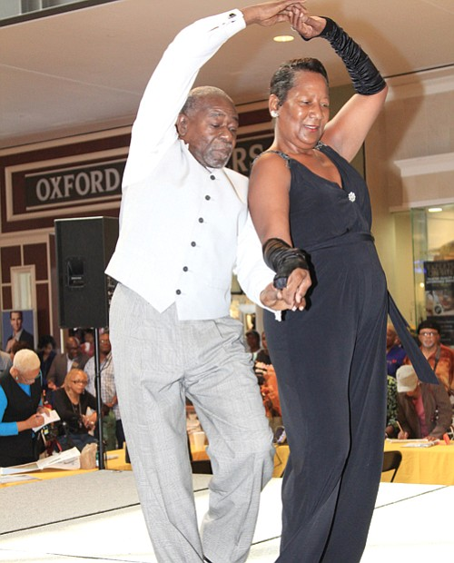 Ballroom dancers Johnny Kimbrough and Angela Sanford cut the rug with fancy moves across the stage floor.